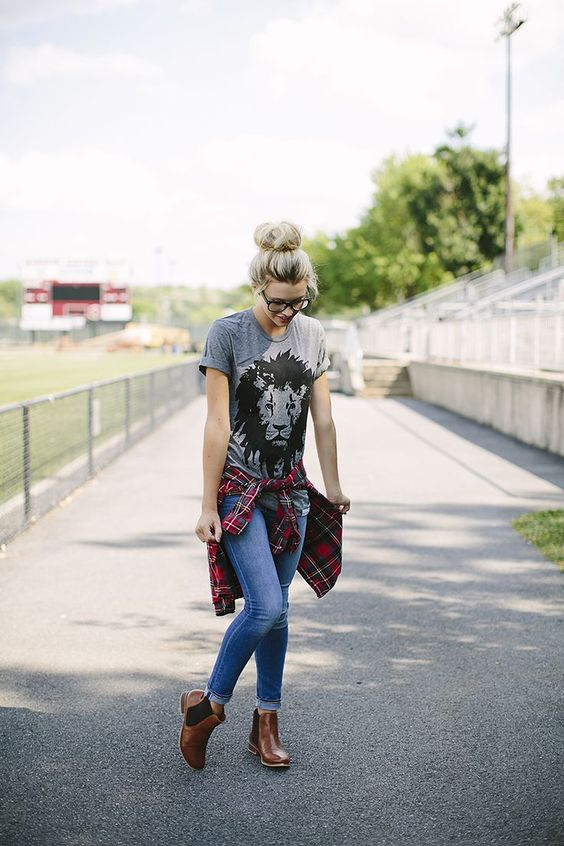 blue jeans, brown booties, a printed grey tee and a plaid shirt to cover up