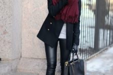 12 leather pants, black booties, a short black coat and a burgundy scarf