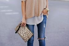 12 nude heels, ripped skinnies, a polka dot shirt and a neutral oversized long sleeve, an animal print clutch