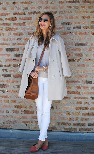 white skinnies, a neutral sweater, a neutral coat and coral flats