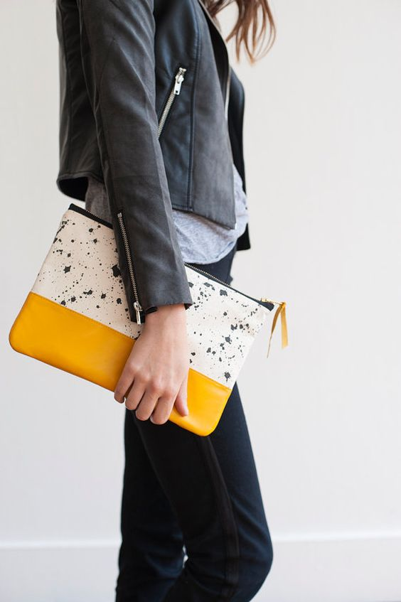a modern clutch, half yellow, half speckled to make a statement