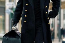 13 a total black look with jeans, boots and a double breasted coat