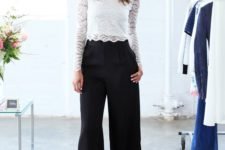 13 black culottes, a white lace crop top with long sleeves and neon yellow heels