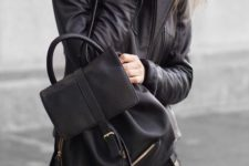 13 black jeans, a black tee, a black leather jacket and backpack for a rock-inspired look