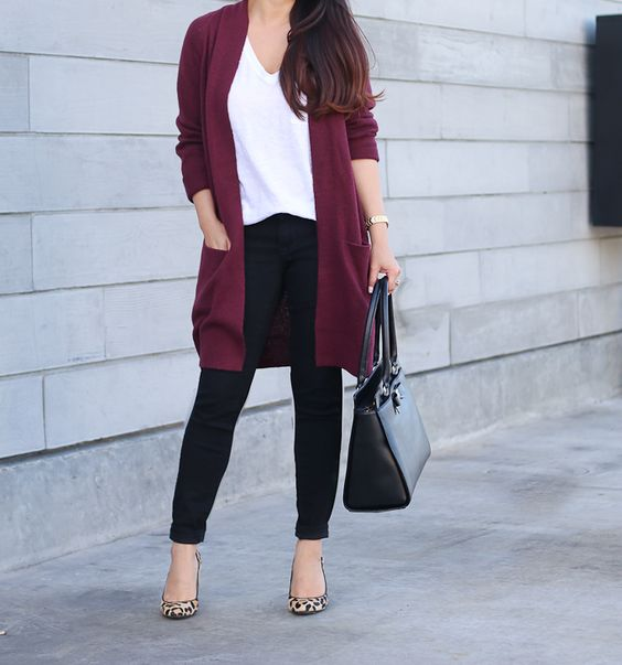 black jeans, a white top, a plum cardigan, leopard print shoes and a black bag