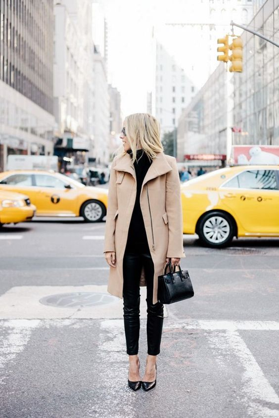 black skinnies, a black turtleneck sweater, black heels and a camel coat