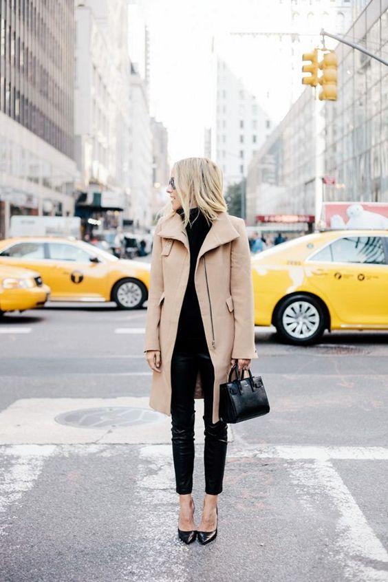 black skinnies, a black turtleneck sweater, black heels and a camel coat