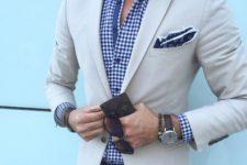 13 blue jeans, a blue gingham shirt and a cream blazer to look dapper