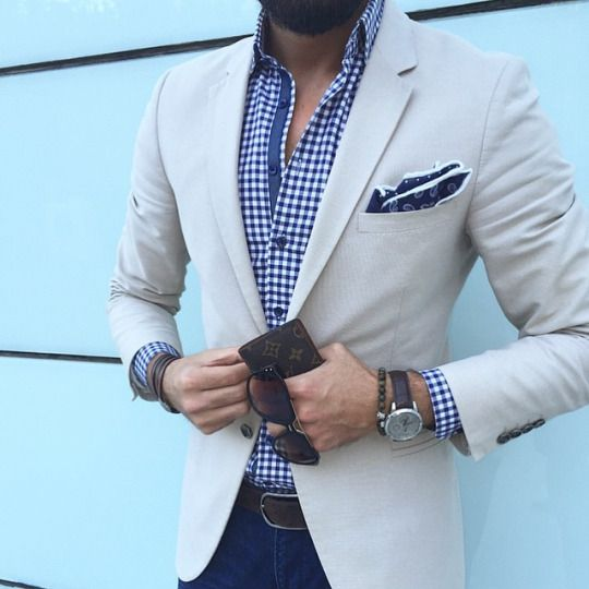 blue jeans, a blue gingham shirt and a cream blazer to look dapper