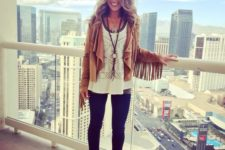 13 blue skinnies, brown booties, layered tops, an amber suede jacket with fringe