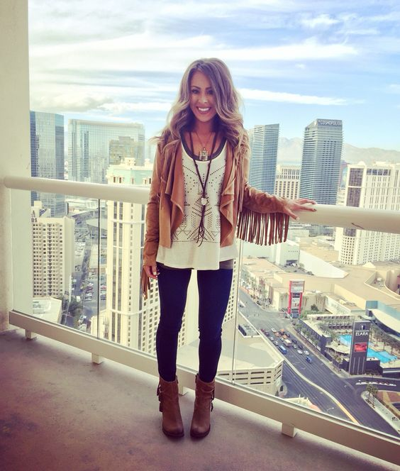 blue skinnies, brown booties, layered tops, an amber suede jacket with fringe