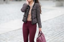 13 burgundy pants, a neutral top, a tweed jacket, a burgundy tote and strands of pearls