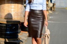 14 a black leather skirt, a blue shirt, a statement necklace, blush lace up heels and a bag