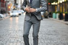 14 a grey suit, a striped tie and brown leather shoes for an elegant look