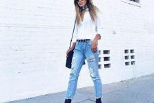 14 a white shirt, ripped jeans, cobalt blue velvet booties