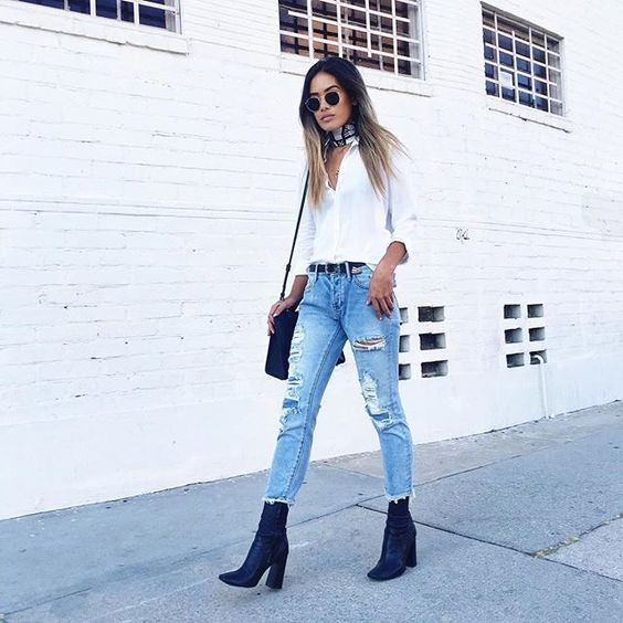 a white shirt, ripped jeans, cobalt blue velvet booties