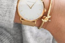 14 an elegant gold watch with gold bracelets for a super elegant and luxurious look