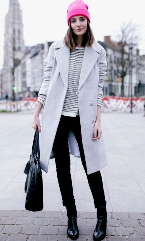 black skinnies, a striped sweater, black boots, a light grey coat and a beanie