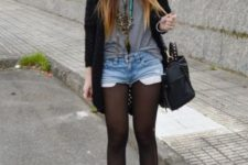 14 denim shorts with stockings, a grey t-shirt, a black cardigan and black leather booties