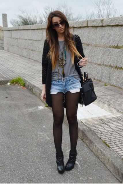 denim shorts with stockings, a grey t-shirt, a black cardigan and black leather booties