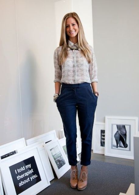 navy pants, a neutral printed shirt, a statement necklace and blush booties