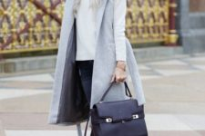14 navy skinnies, a white sweater, a grey sleeveless coat, black suede booties and a black bag