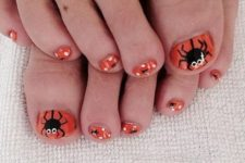 14 orange toe nails with spiders and polka dots look cut yet Halloween-like