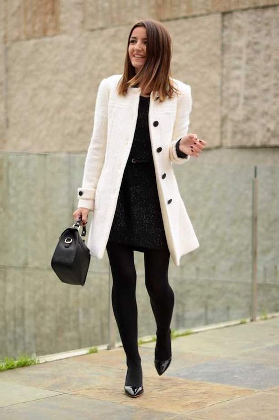 a black dress, a belt, a white coat with black buttons, black lacquered heels, black tights and a bag