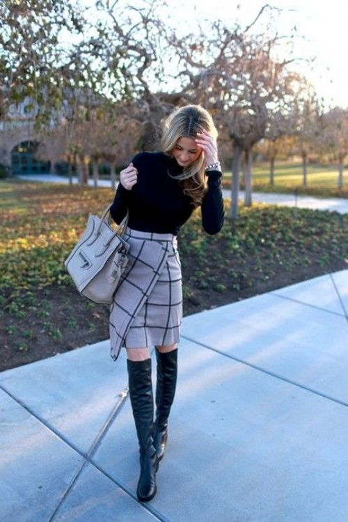 a black sweater, a windowpane print grey skirt and black tall boots for a girlish look