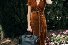15 a mustard V-neckline high low dress with black heels