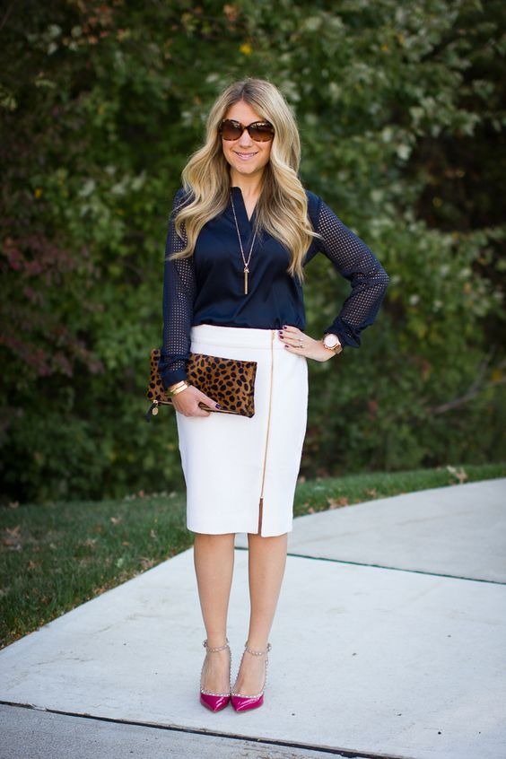 a white zip pencil skirt, a navy shirt, hot pink shoes and a leopard clutch
