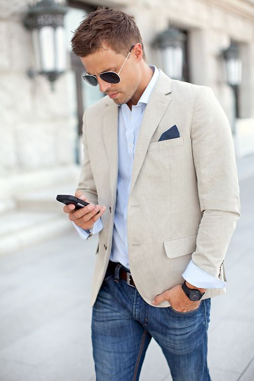 blue jeans, a white shirt and a creamy colored blazer for a preppy look