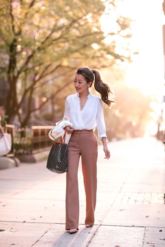 dusty pink flare trousers, a flowy white blouse and nude heels