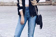 15 high waist blue jeans, a crop top, an embroidered bomber jacket and black leather boots