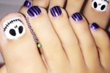 15 purple and black toe nails plus accent nails with a ghost face in black and white