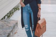 15 ripped cropper blue jeans, a black long shirt, brown lace up heels and a matching backpack