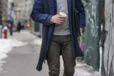 16 a blue coat, olive green pants, a grey sweater for a chic layered look
