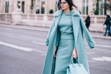 16 a grey suit with a top and a midi pencil skirt, a matching coat and blue shoes