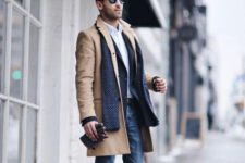 16 a layered fall look with jeans, a camel coat, a blazer and brown shoes