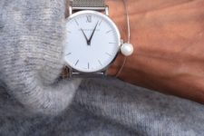 16 a minimalist watch on a silver band with a silver pearl bracelet for a modern or minimalist outfit