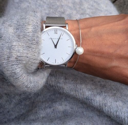 a minimalist watch on a silver band with a silver pearl bracelet for a modern or minimalist outfit
