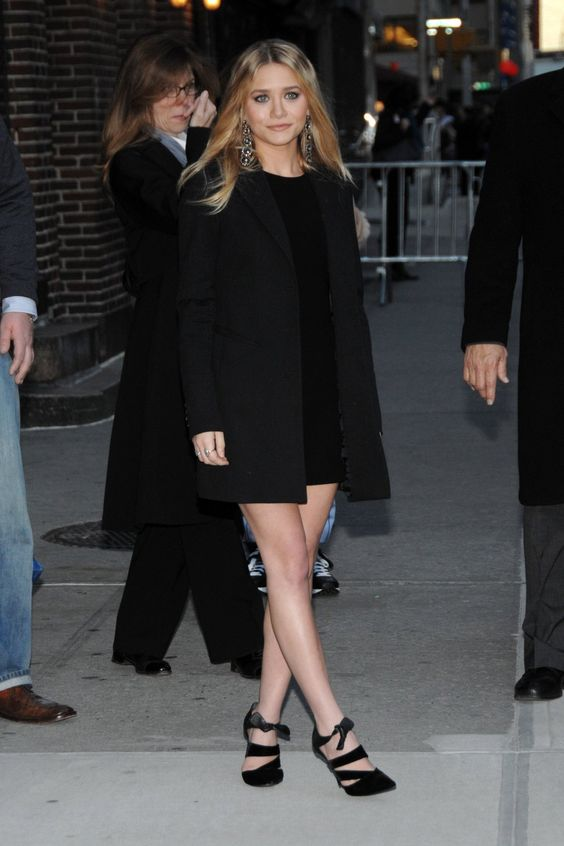 a total black look with a black mini dress, a black short coat and gorgeous heels