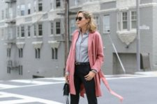 16 black cropped pants, black shoes, a grey shirt, a pink over the knee coat