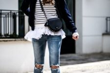 16 navy velvet booties, ripped jeans, a white and black sweater, a shirt and a navy blazer