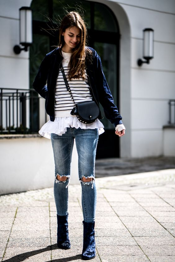 navy velvet booties, ripped jeans, a white and black sweater, a shirt and a navy blazer
