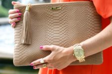 16 snake texture beige leather clutch with a tassel will fit many looks