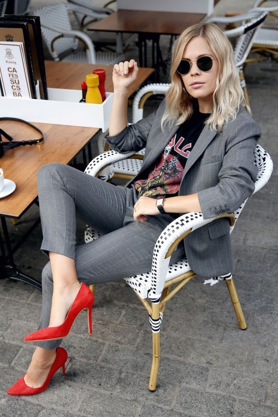 thin striped grey suit with cropped pants, a rock-inspired top and red suede shoes