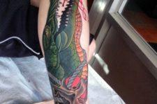 Alligator tattoo on the arm