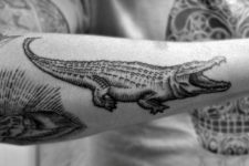 Alligator tattoo on the forearm