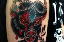 Angry bison and arrow tattoo on the arm